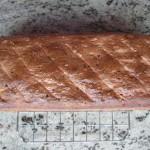 Chleb stygnie na kratce tuż po posmarowaniu olejem