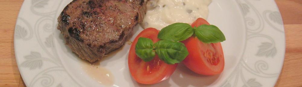 Stek wołowy polany sosem z zielonego pieprzu